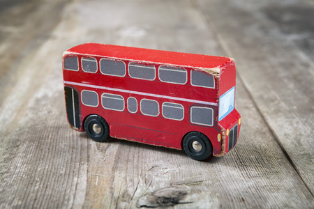 cars race: Old wooden English red bus Stock Photo