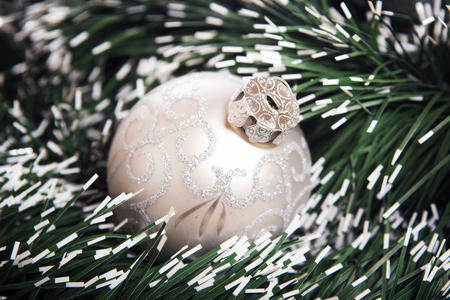 Brilliant  baubles like christmas decoration. Ball on green background.