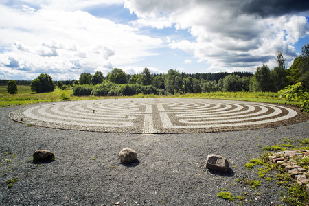 Gothic labyrinth from black and white cobble-stones in the field. Europe. Letonia. Symbol of a new way, clarification Stock Photo