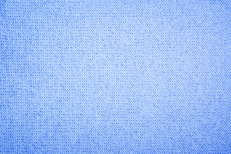 tejido de lana: Blue structure of a  knitted woolen fabric background