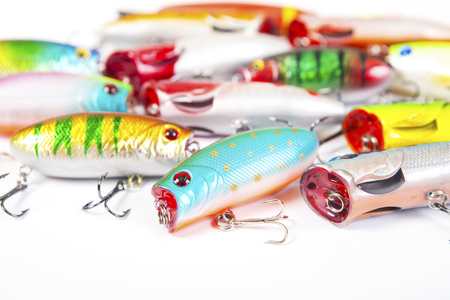 Set of fishing spinners and wobblers multi-colored background Stock Photo