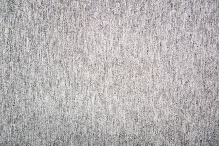tejido de lana: Gray structure of a  knitted woolen fabric background     Foto de archivo