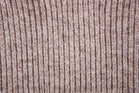 tejido de lana: Brown structure of a  knitted woolen fabric background
