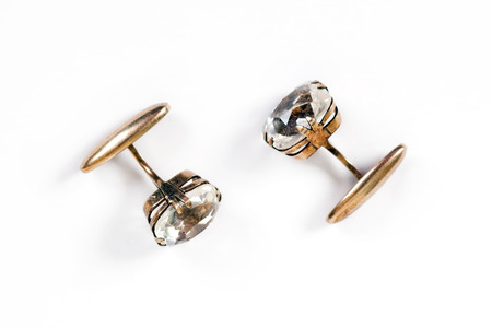 Ancient gold mens cuff links with rock crystal are isolated on a white background