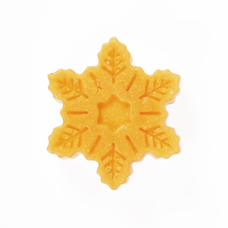 dafne: Handmade soap in the snowflake form is isolated on a white background