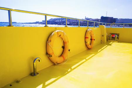 Lifebuoy on a boats deck. Concept of safe sea walk.