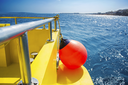 saving buoy on a boats deck. Concept of safe sea walk.
