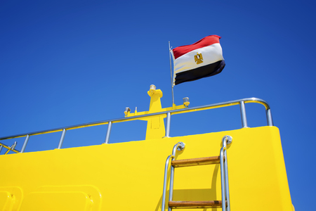 Egyptian flag on a boats deck. Concept of sea walk.