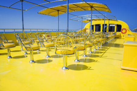 Row of chairs on the yellow boat