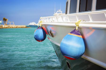 saving buoys on a boats deck. Concept of safe sea walk. Stock Photo