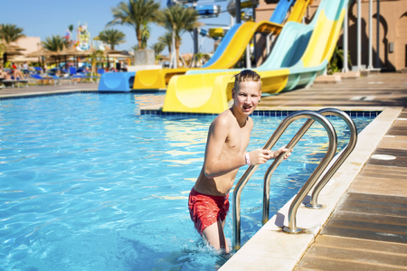 Boy leaves the pool after swimming.Safety concept in the pool Stock Photo