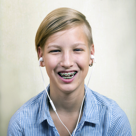 Teen with braces on his teeth. Orthodontics and bite correction. Stock Photo