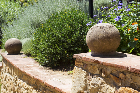 Garden of flower.Part of a ladder with stone spheres in a garden. Horizontal image. Selective focus.