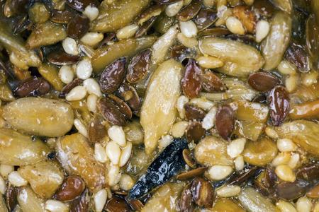 Oriental sweets Kozinaki - sunflower seeds in caramel macro side view