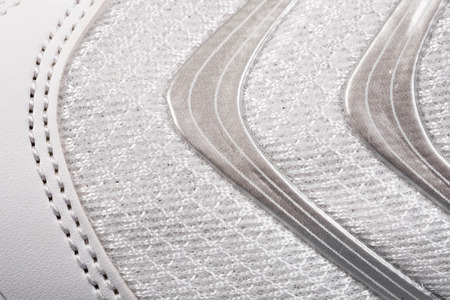 Sports shoes close up background. Texture of fabric macro background  Stock Photo