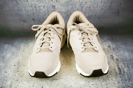 Pair of men's sports shoes on a concrete background 写真素材