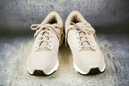 Pair of men's sports shoes on a concrete background Reklamní fotografie