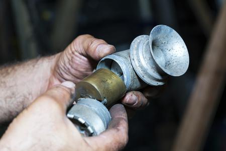 Old car carburator in the man hand Banco de Imagens
