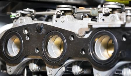 Car carburator,engine intake side receiver closeup in service Banco de Imagens