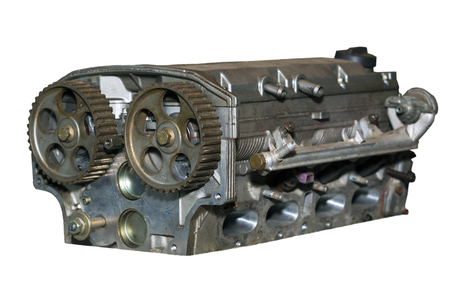 Car engine cylinder head after machine and assembly isolated on white background