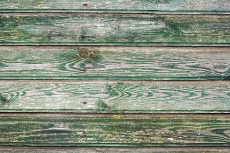 The texture of the old Board with peeling green paint Banco de Imagens
