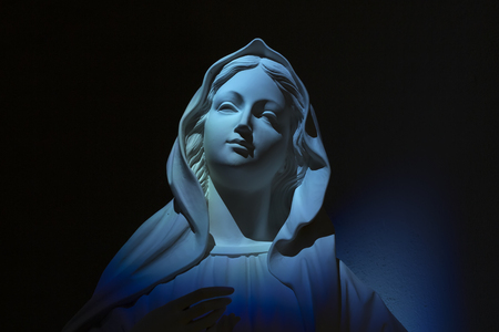 Virgin Mary our lady of grace on blue light 版權商用圖片