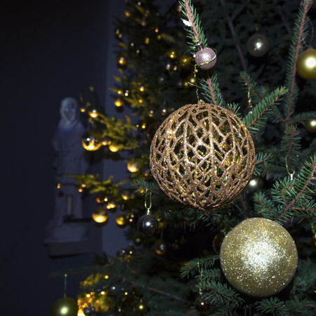 Fir branch with balls and festive lights on the Christmas background with sparkles Banco de Imagens