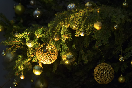 Fir branch with balls and festive lights on the Christmas background with sparkles Banco de Imagens - 117289848