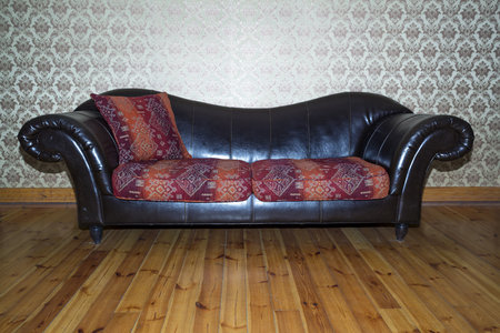 The vintage leather sofa in living room