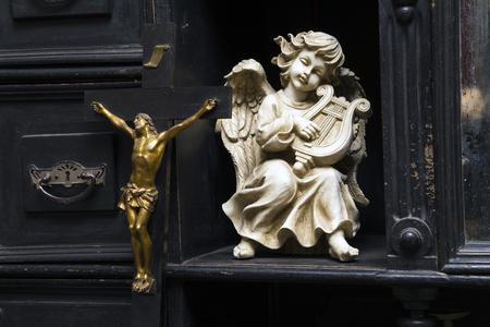 Vintage figurines on an ancient wooden dresser