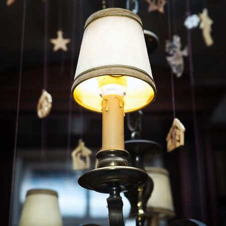 Christmas Lantern with decorations on dark background. Banco de Imagens