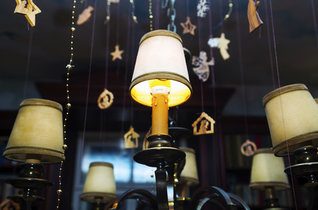 Christmas Lamps with decorations on dark background.