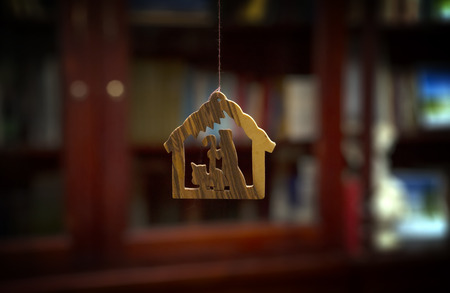 decorative wooden house and Christmas decorations