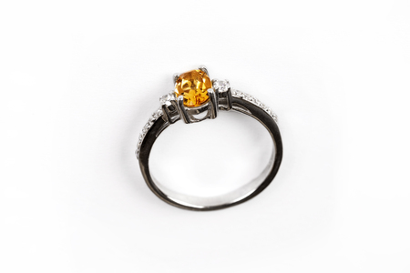 Diamond RingElegance luxury ring with yellow gem isolated on white background