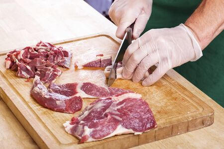 Separation of a raw mutton meat with rib for meat portions