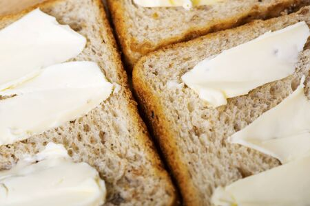 Sliced toast bread with butter background. Simple breakfast. Top view
