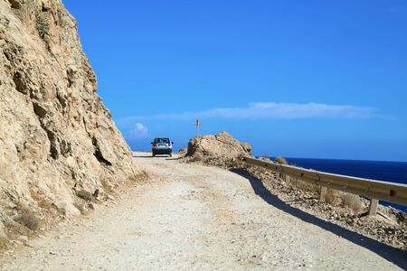 Car on the steep and shallow dangerous mountain road Stok Fotoğraf