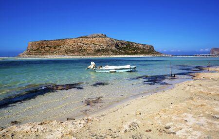 Balos lagoon on Crete island, Greece.Boat in crystal clear water