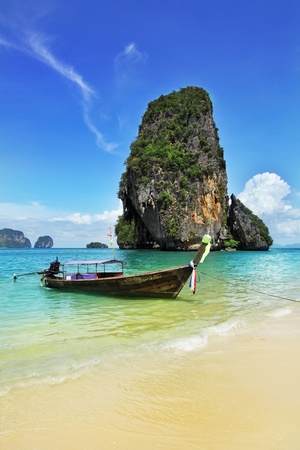 Seascape whith exotic island and long tail boat in Thailand photo