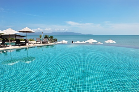 Tropical resort. Poolside with sea view photo