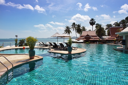 Tropical resort. Poolside with beautiful sea view Imagens - 11651727
