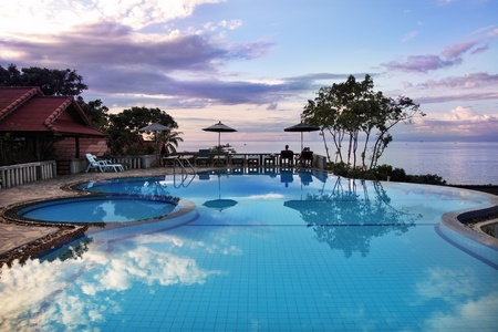 Tropical resort. Poolside with beautiful sea view