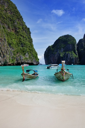 A long tail boats in Maya Bay, Koh Phi Phi Ley, Thailand. The place where the movie the Beach was filmed.