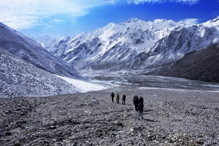Group of hikers with mountain range, Langtang region, Nepal