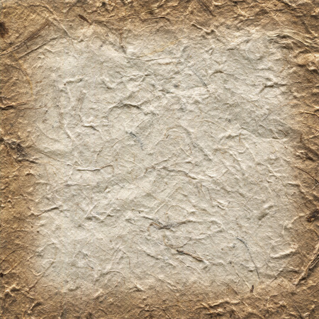 Handmade old wrinkled beige rice paper texture. Background with burned brown edge gradient. Banco de Imagens