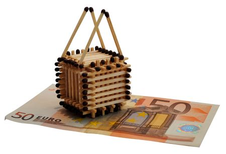 House that is building with matches stands on 50 euro bond. Isolated over white.
