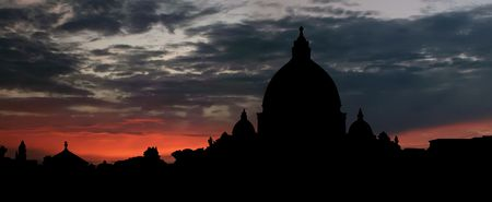 The Papal Basilica of Saint Peter over dawn background