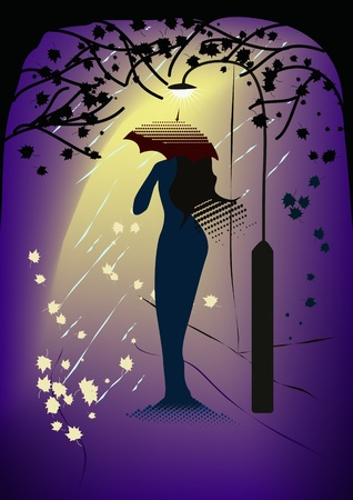 Mirage-like woman with umbrella standing in the light of street lamp.