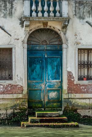old doors: The door of an venetian house, Grand Channel, Venice, Italy