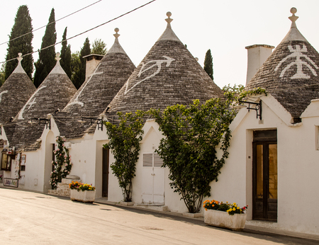 unique characteristics: The street of Alberobello with trulli, Puglia, Italy Stock Photo